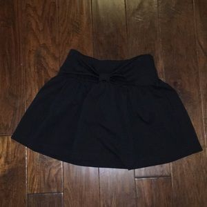 Black Kate Spade skirt, with a bow on the front